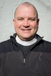 The Rev, Mack Olson