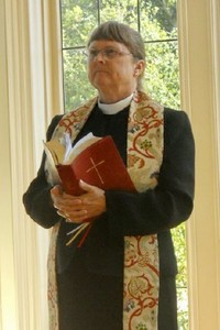 The Reverend Linda Huggard,      Priest in Charge